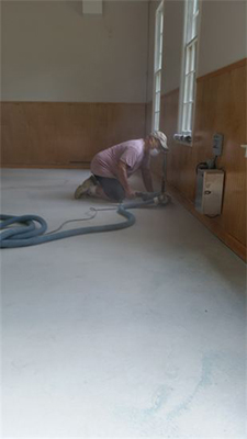 grinding edges of garage floors as part of prep work for epoxy coatings